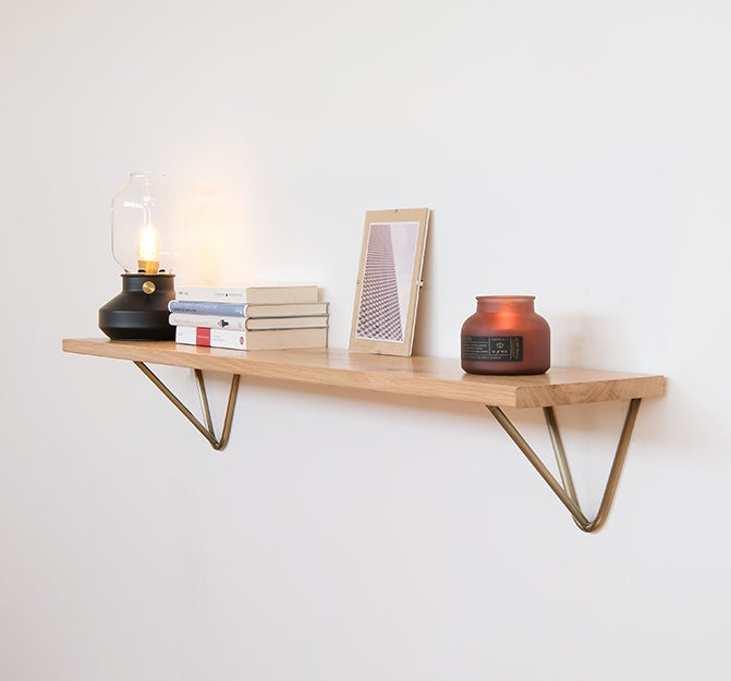 floating shelf with books and candles on it