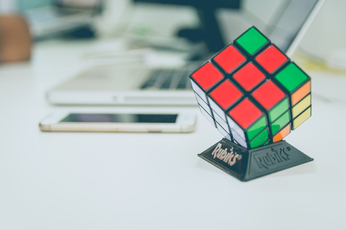 A Rubik's Cube displayed on a stand
