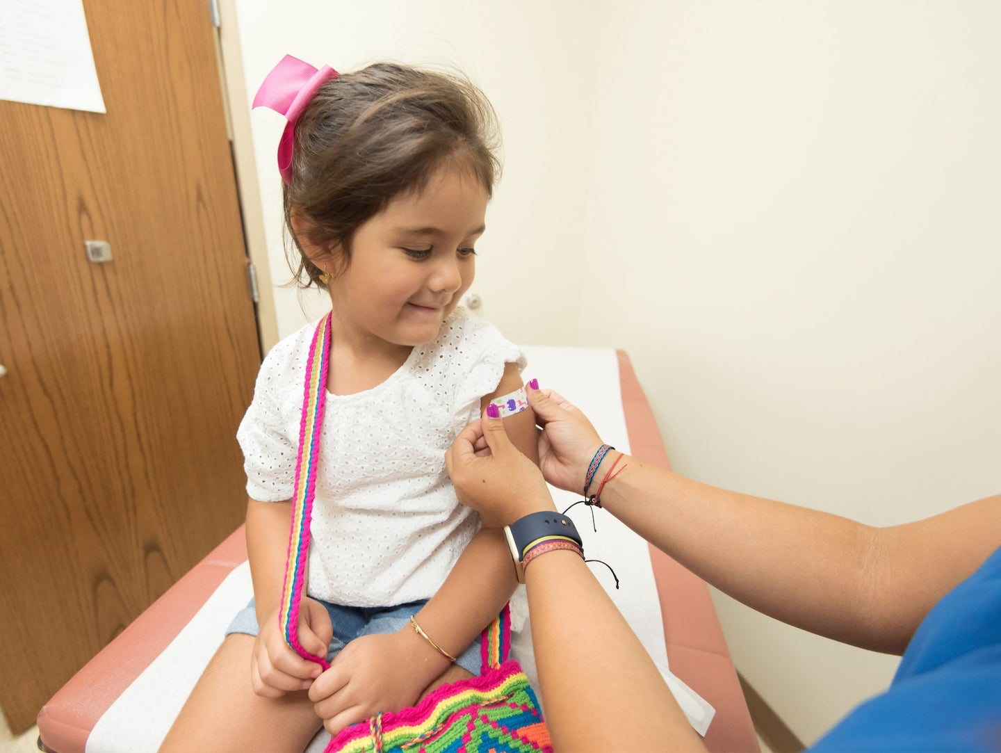 child getting bandage after a vaccine