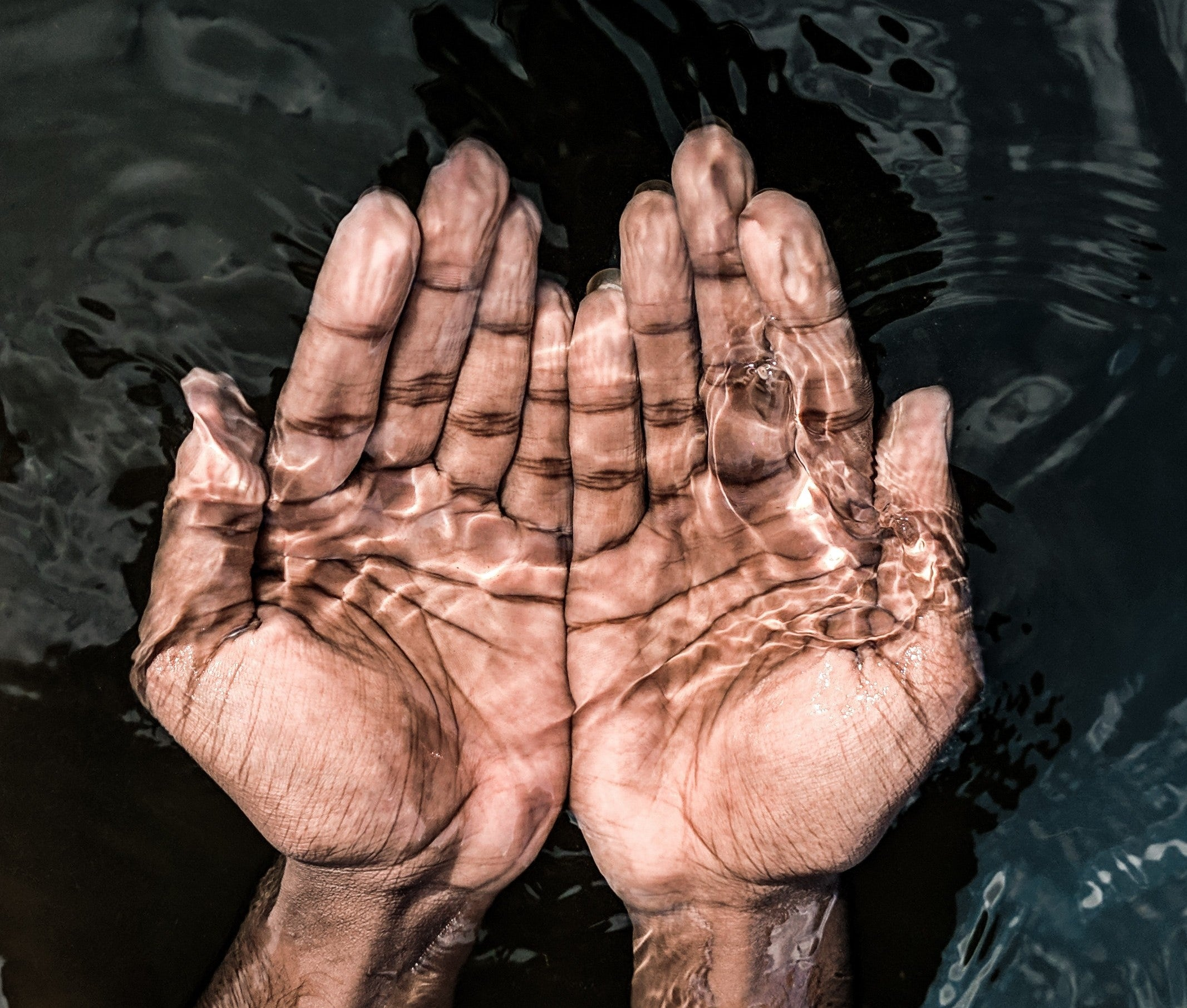 a person with their hands in the water