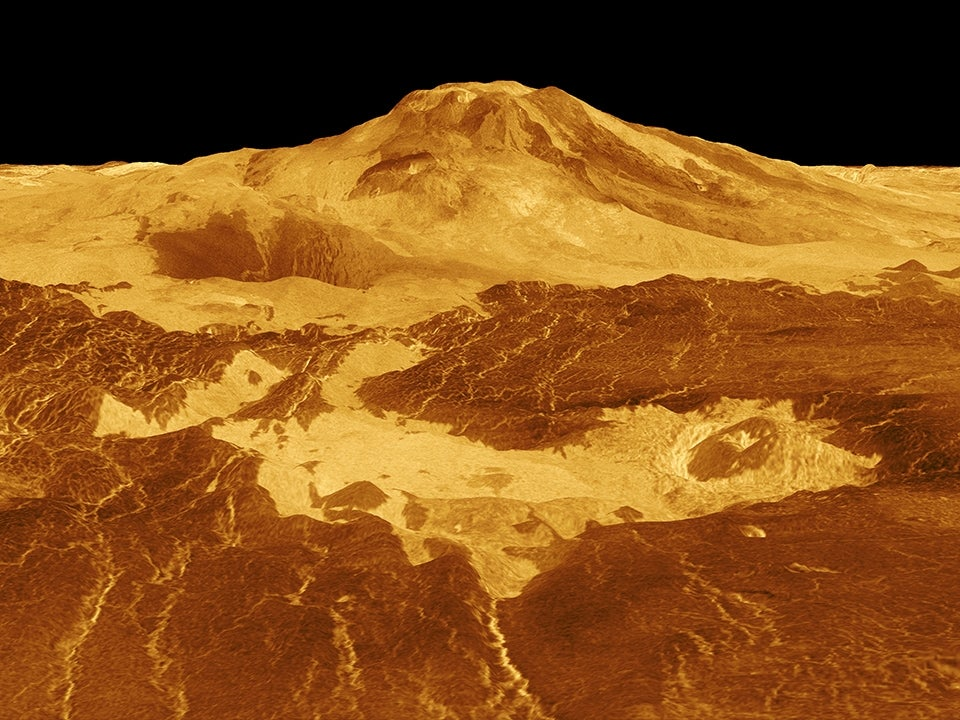Lava flows extend for hundreds of kilometers across the fractured plains shown in the foreground, to the base of Maat Mons on Venus.