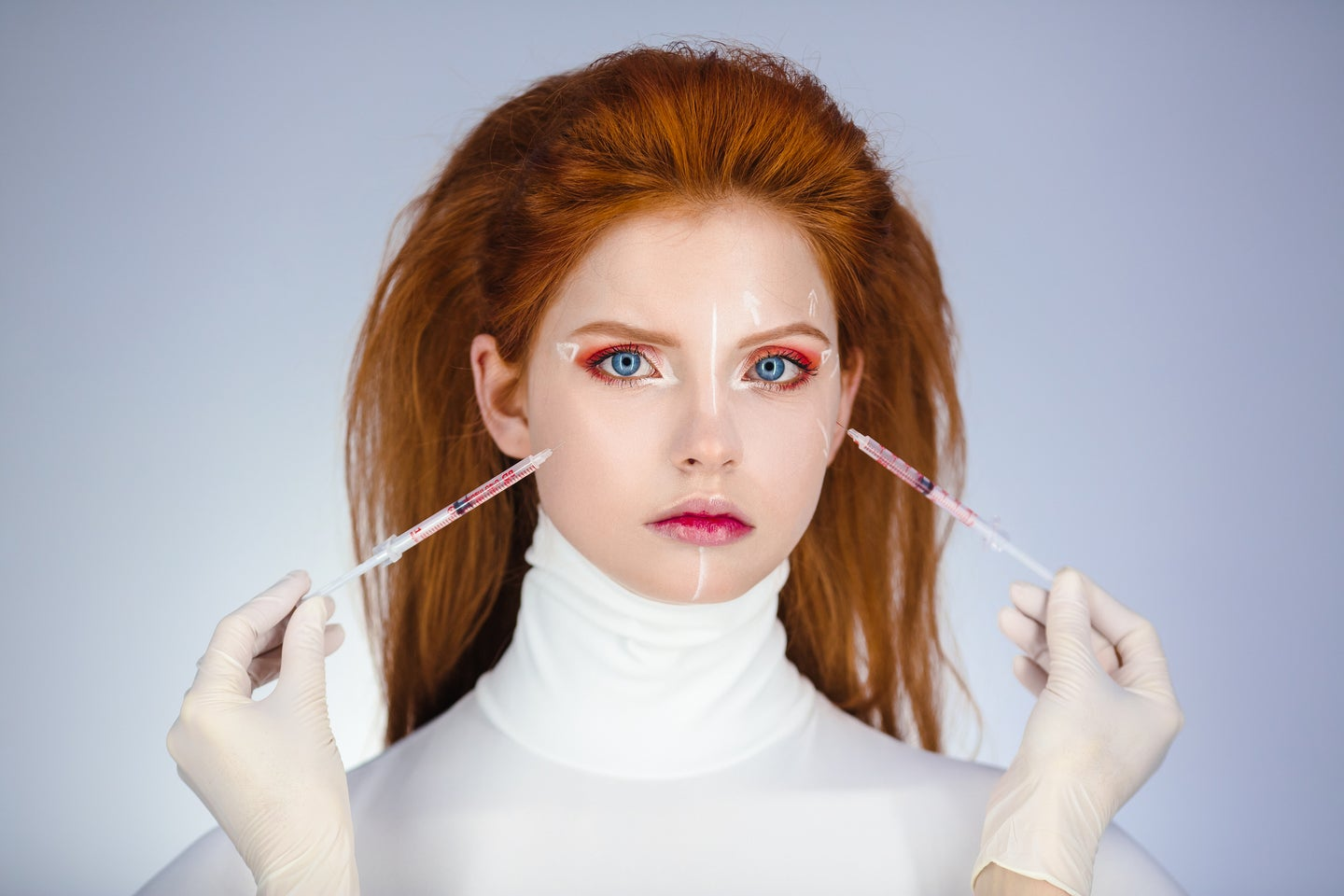 A conceptual botox procedure on a red-haired model