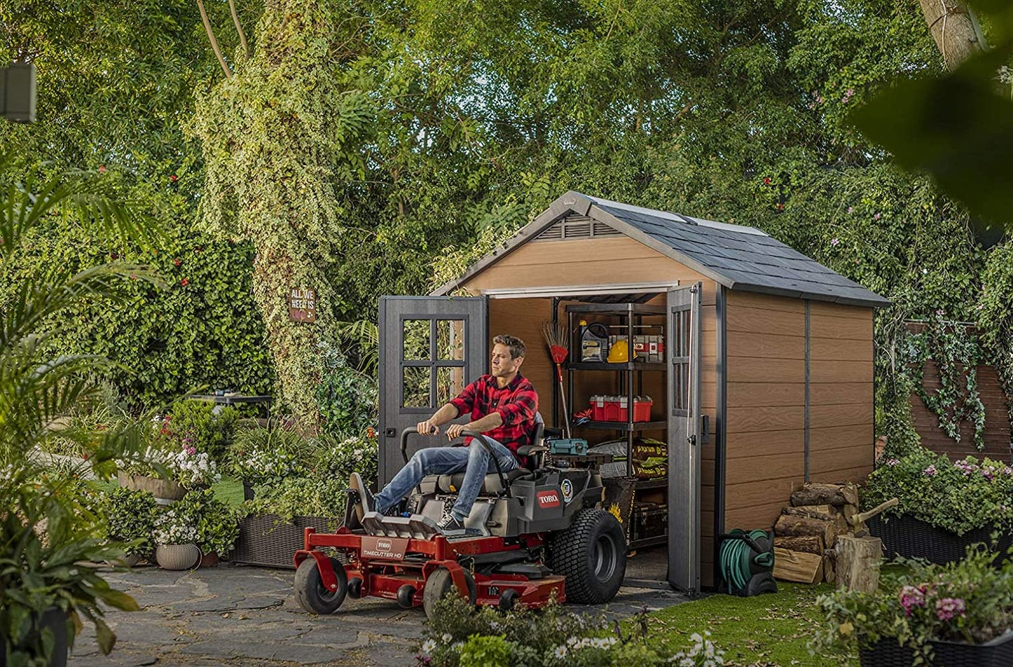 person driving out of a shed