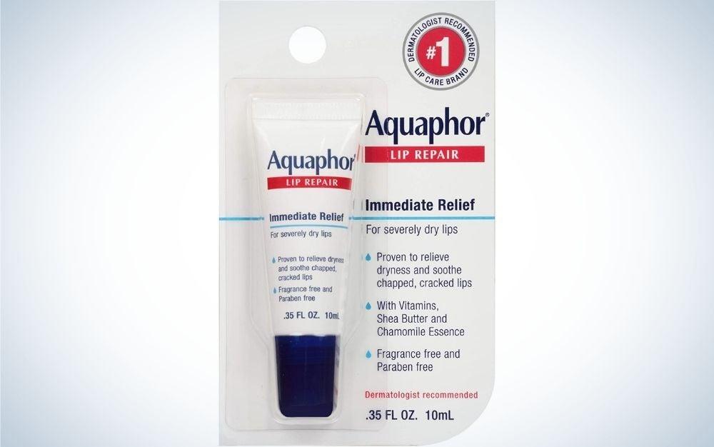 A translucent box with lip softener in it, written Aquaphor.