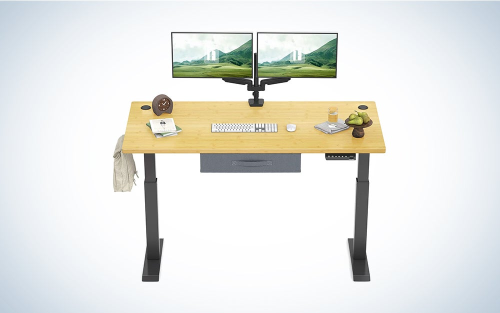 FEZIBO Electric Height Adjustable Standing Desk with Drawer, 48 x 24 Inches Splice Board, Black Frame/Bamboo Top