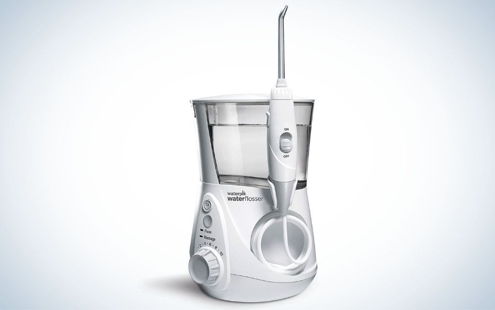 White, electric corded water flosser