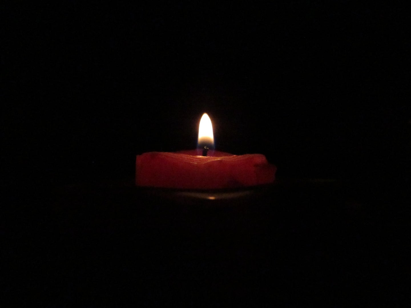 a candle in the darkness