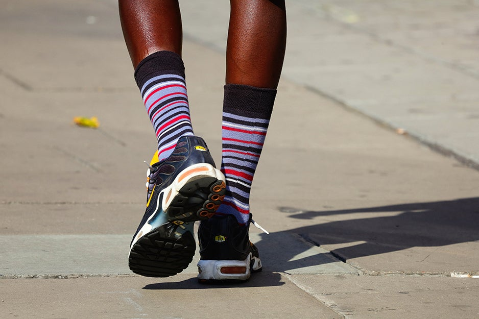 person in running shoes with high socks