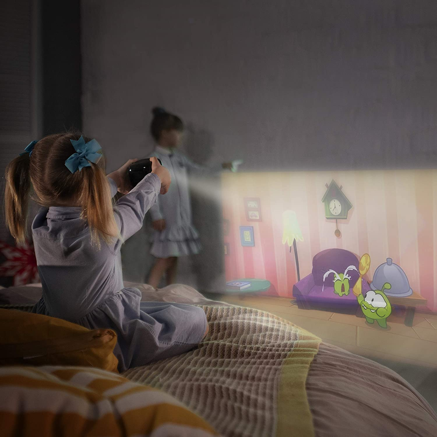 kids with a portable projector