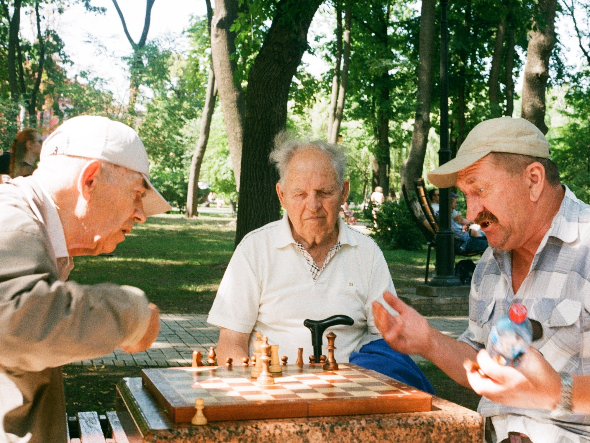 older adult men playing chess together
