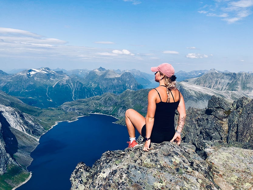 woman on top of a mountain