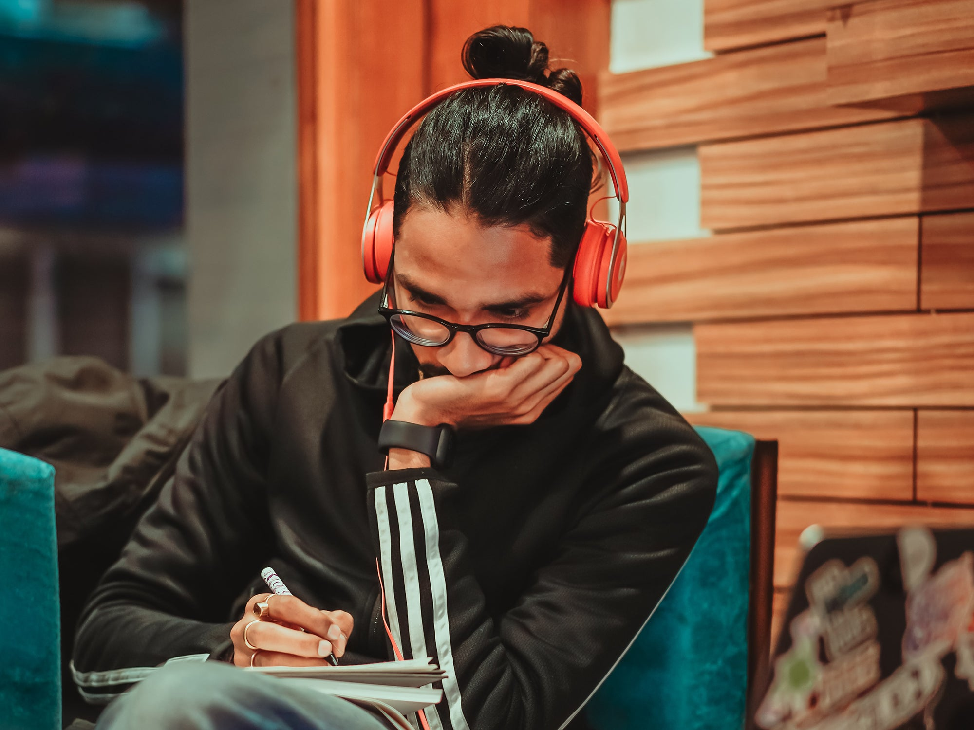 a man with headphones listening to podcasts or music