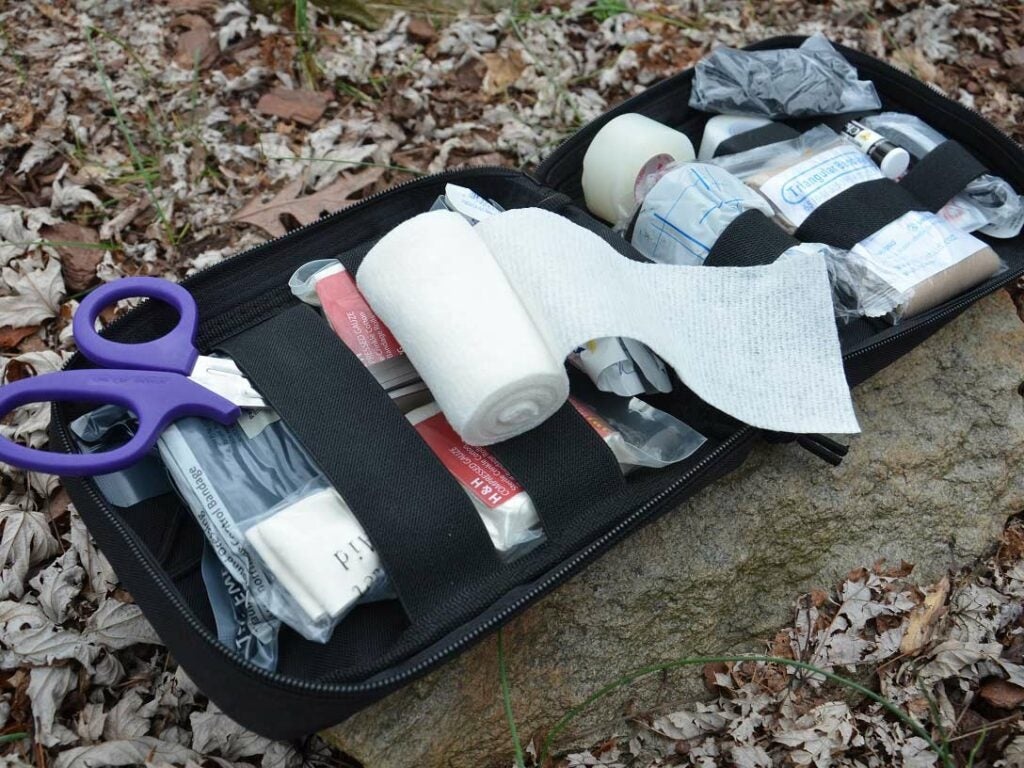 A collection of first aid supplies in a kit.