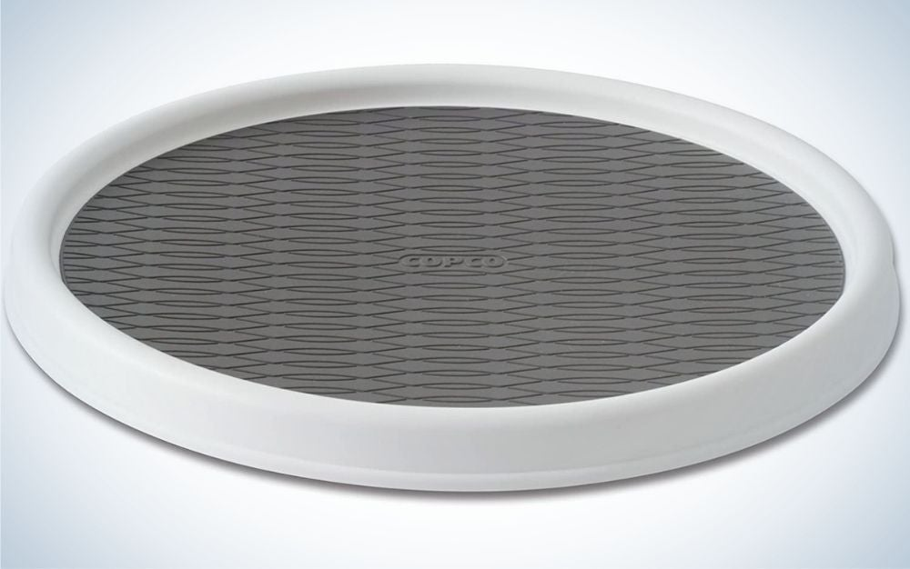 A turntable cabinet with two colors, gray and white on the side, in an oval and large shape.