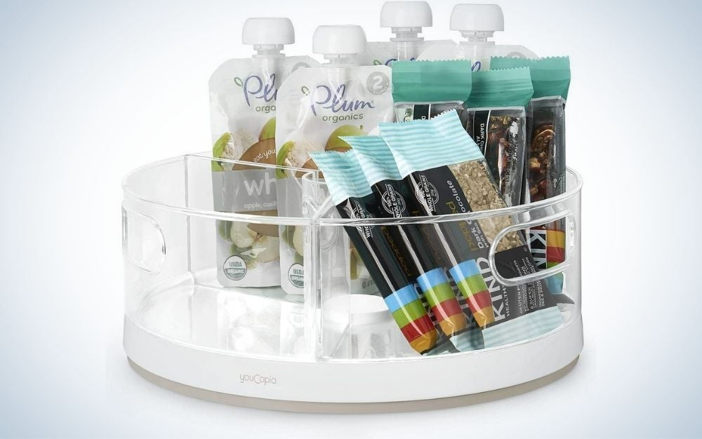 A translucent plastic turntable and filled with all the ingredients of a kitchen as well as a good organizer of them which are in the form of snacks or various white packages.