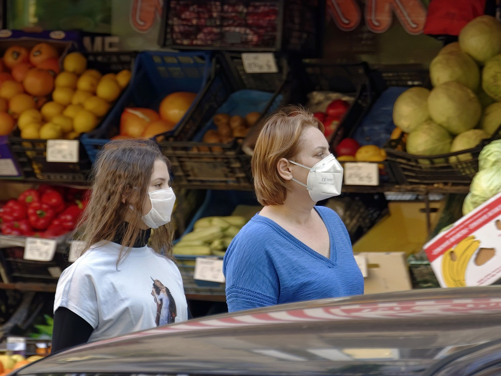 women wearing masks at the grocery store
