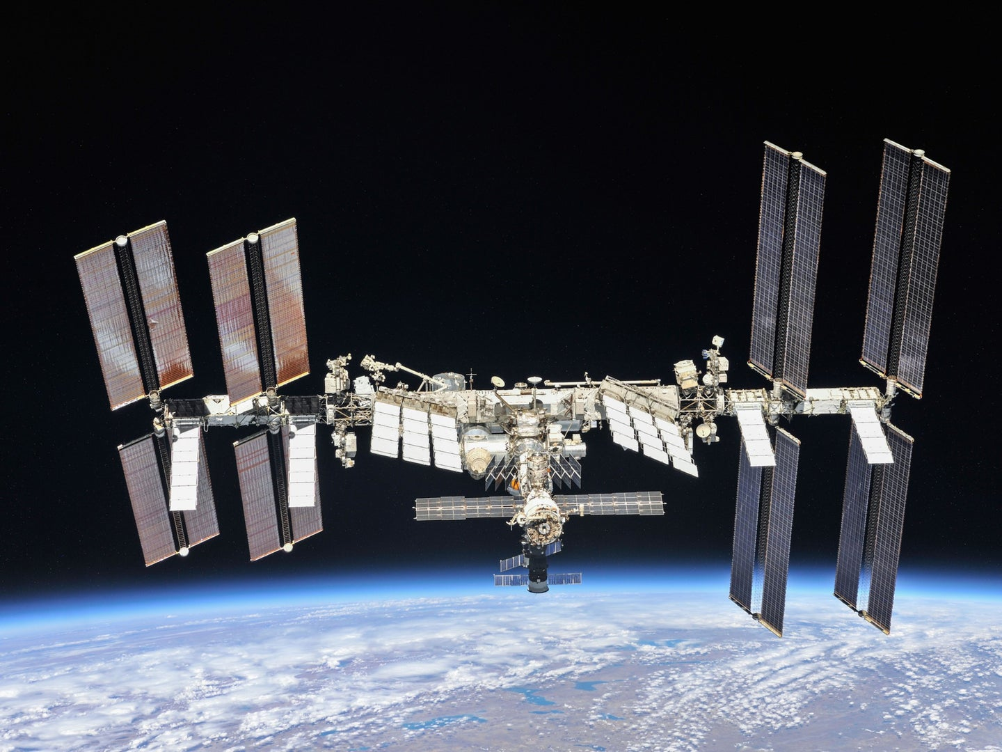 A photograph of the International Space Station floating 250 miles above the Earth.