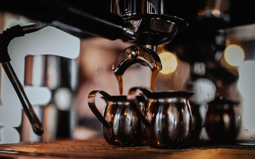 Black coffee maker brewing coffee