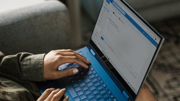 a person using a Windows 10 laptop