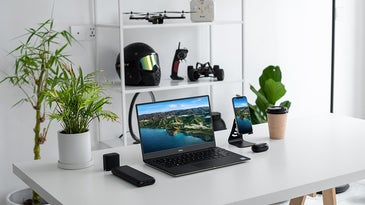 desk with laptop and other gadgets