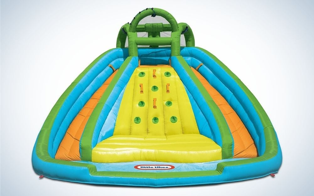 Colorful, rocky mountain river race inflatable slide bounce house