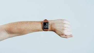 person with an apple watch on their wrist
