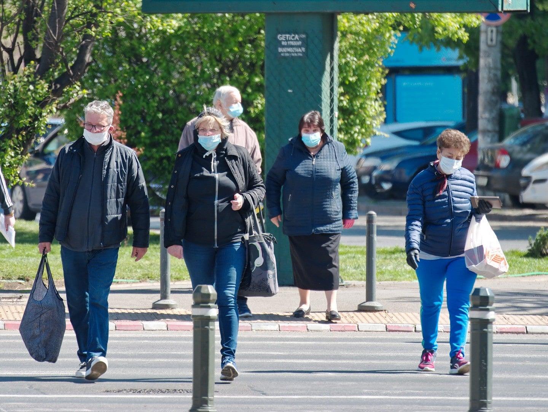 people walking around in masks