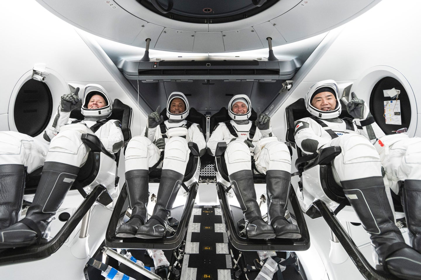 The Crew-1 crew. From left to right, NASA astronauts Shannon Walker, Victor Glover, and Mike Hopkins, and JAXA astronaut Soichi Noguchi.