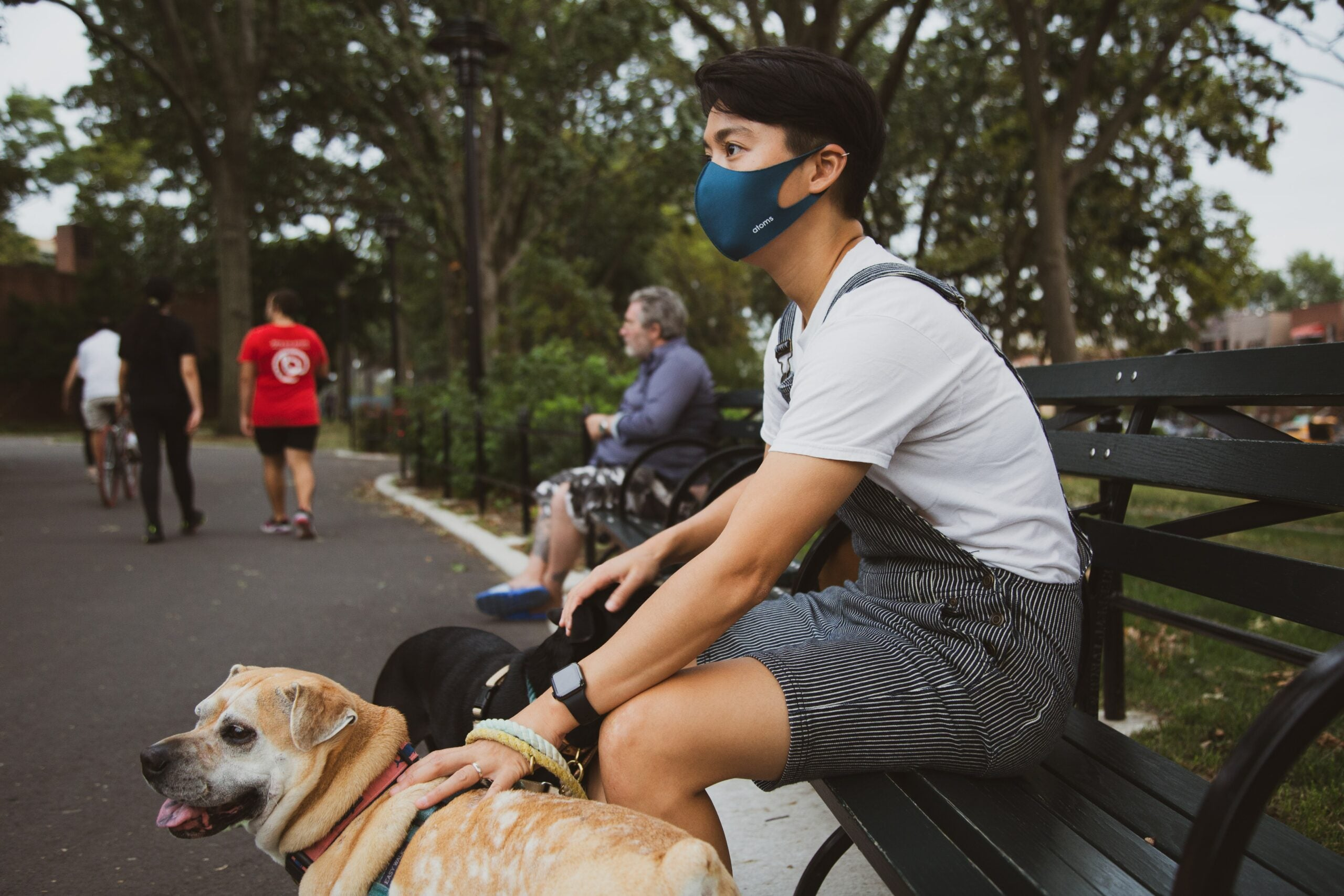 a person in the park wearing a mask