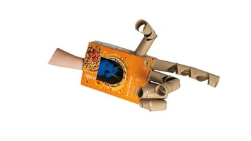 The finished cardboard robotic hand on someone's hand