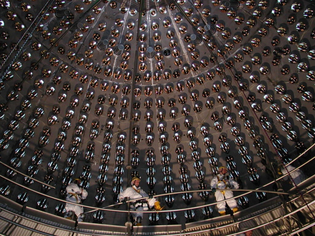 Workers install phototubes in the detector's core, before it was filled with hundreds of tons of liquid.