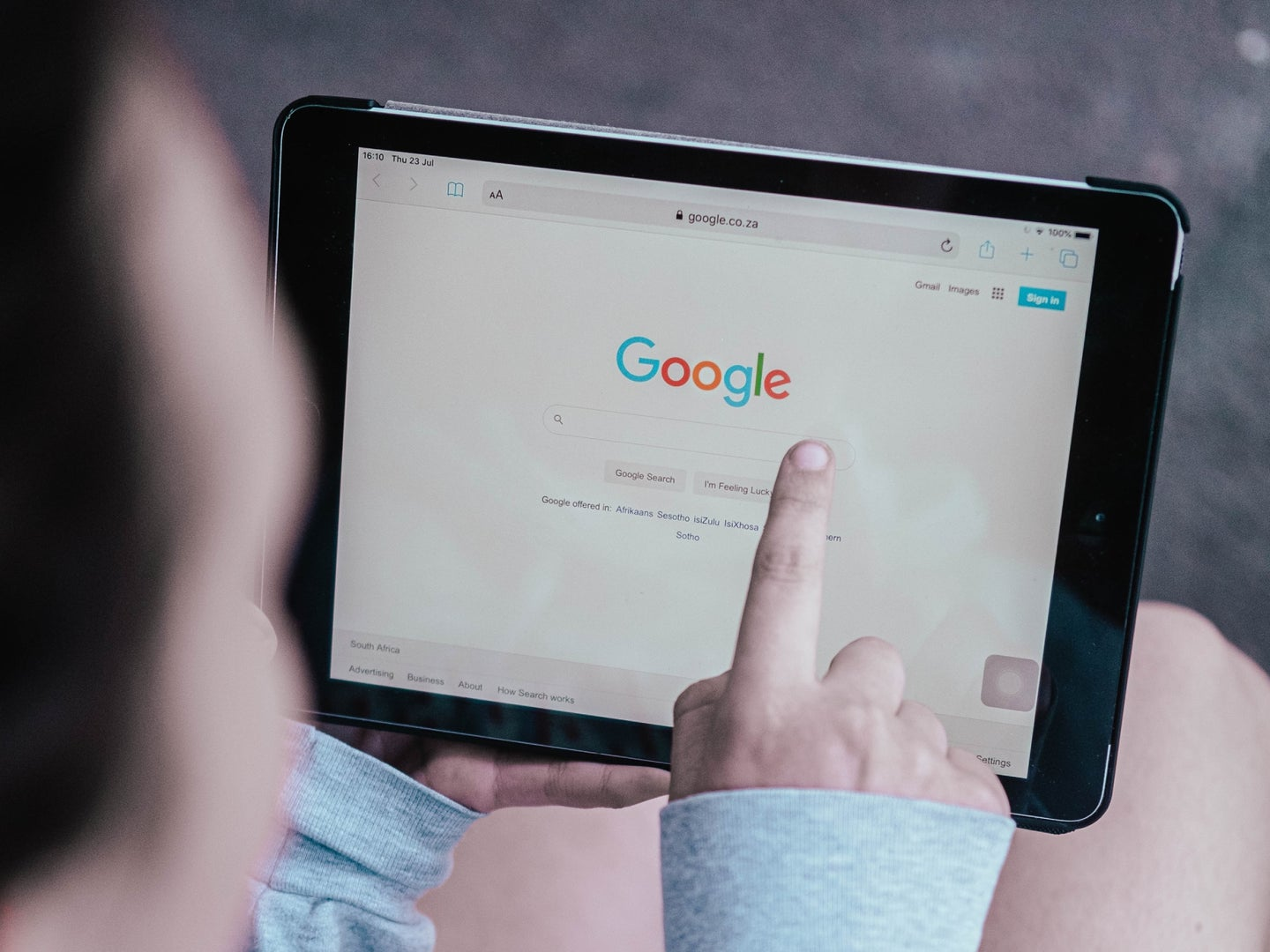 a person using the Google search engine on a tablet