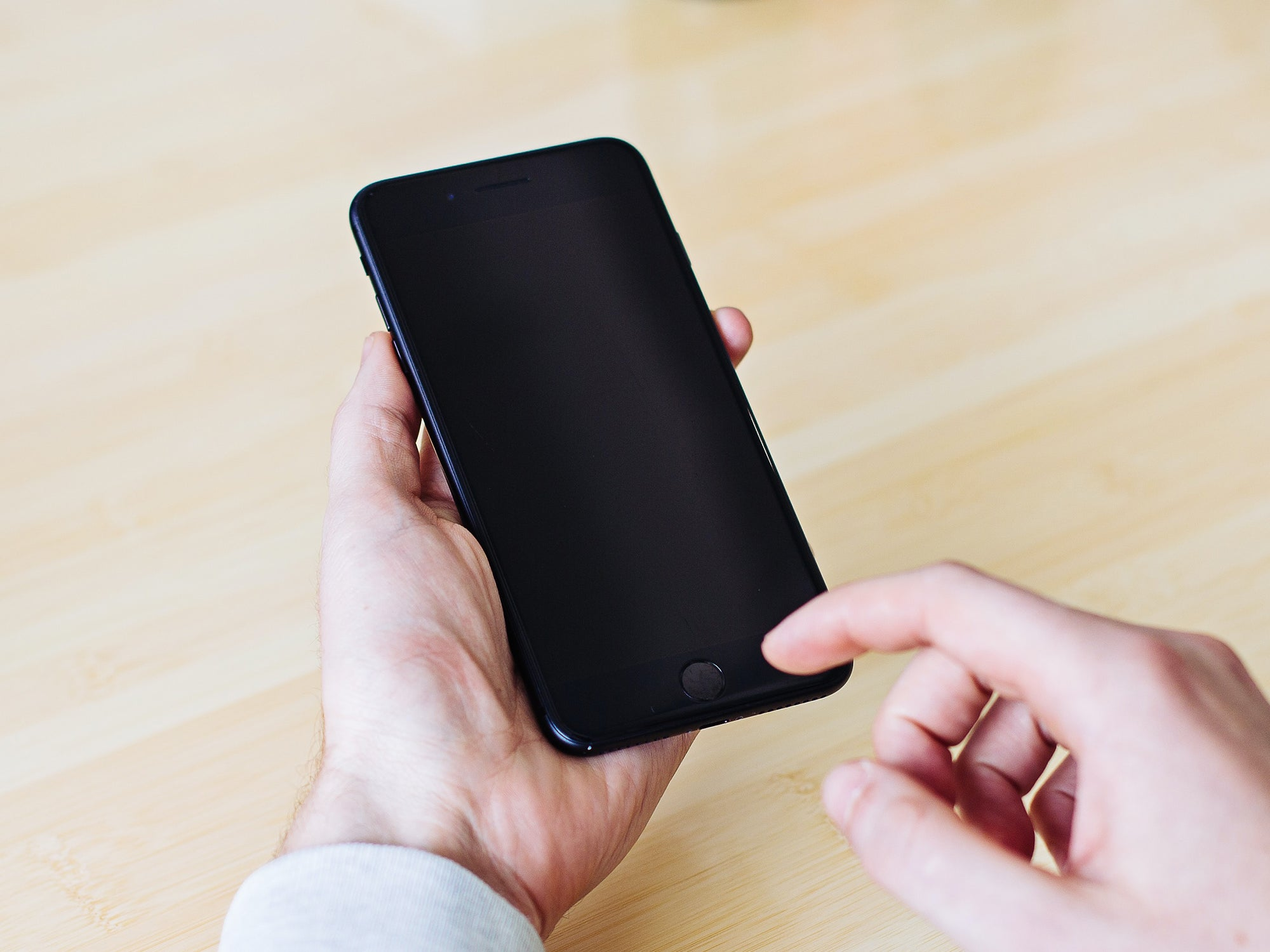 a person holding a dead phone in their hands