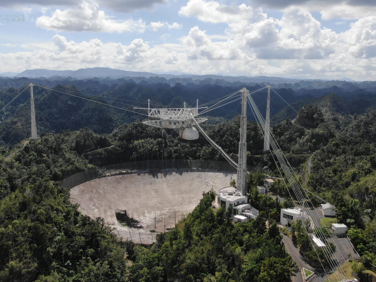 Arecibo's disk suffered damage in November, before the suspended receiver collapsed completely in December.