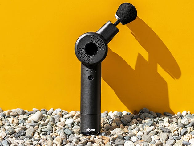 Massage gun against a wall