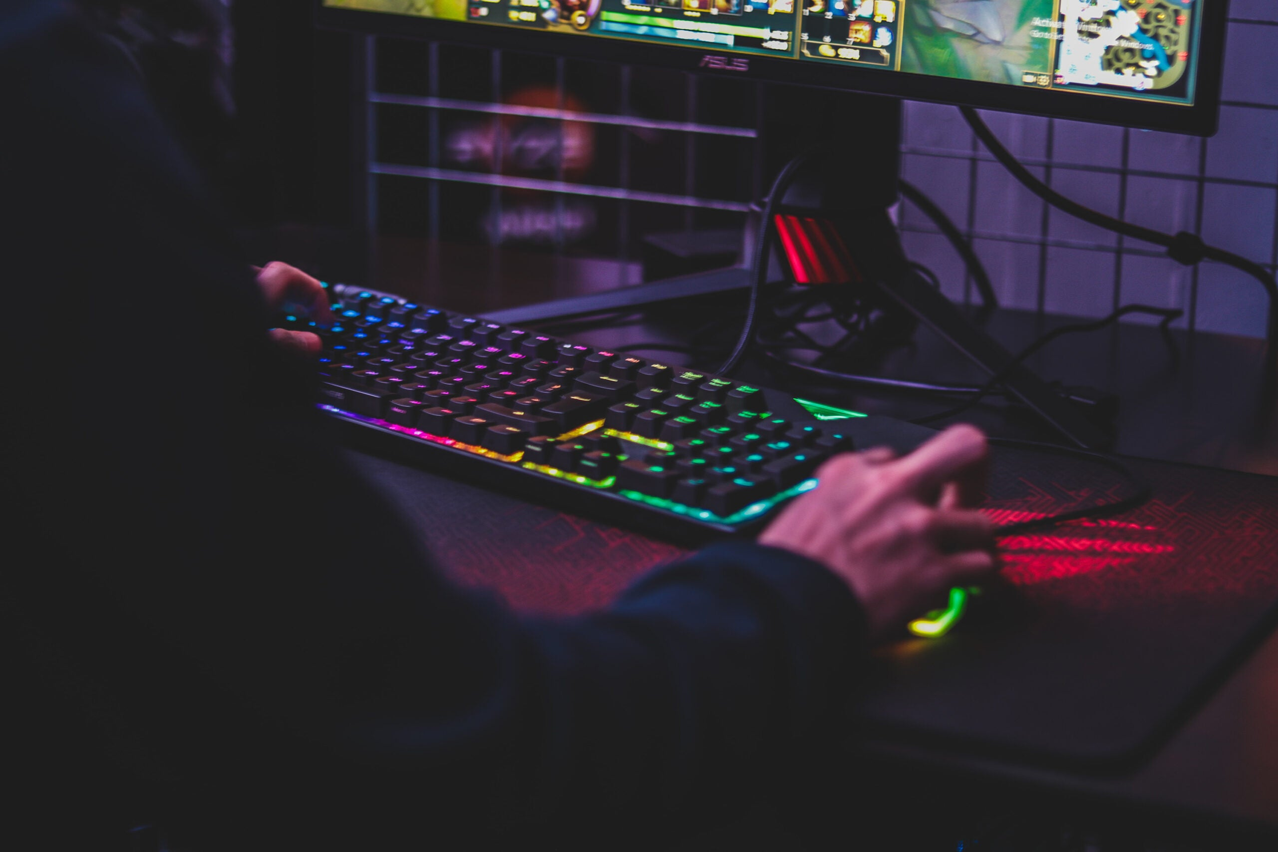 Person using a gaming mouse and ergonomic keyboard.