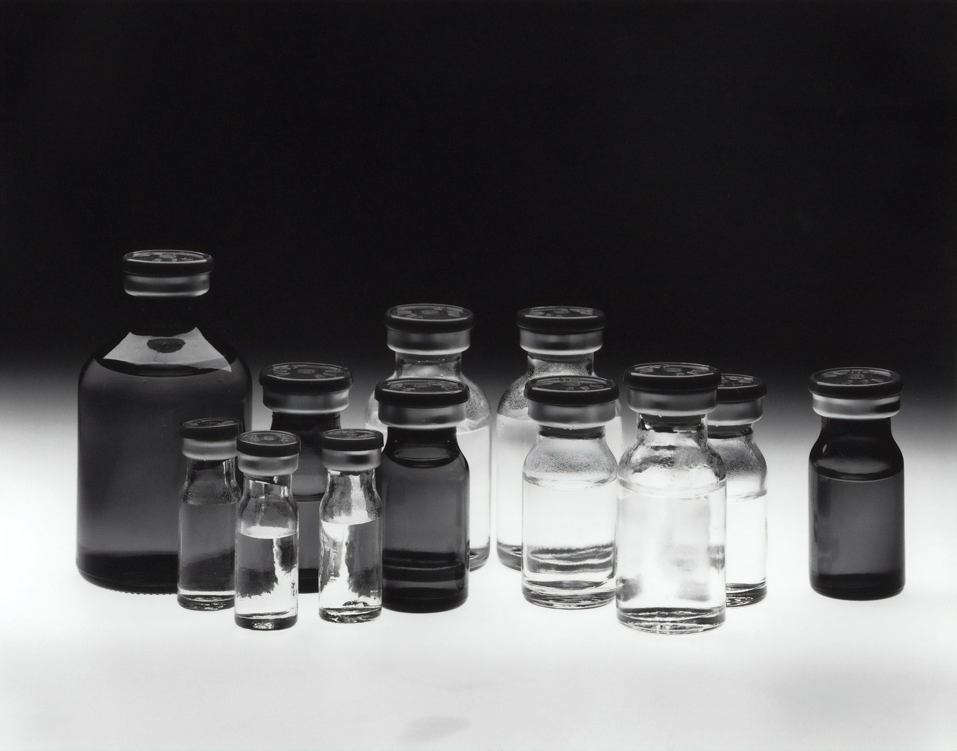 Chemotherapy-drug bottles in black and white