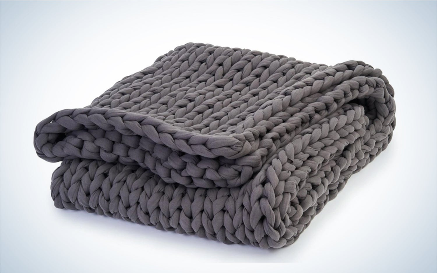 a gray blanket on a white background
