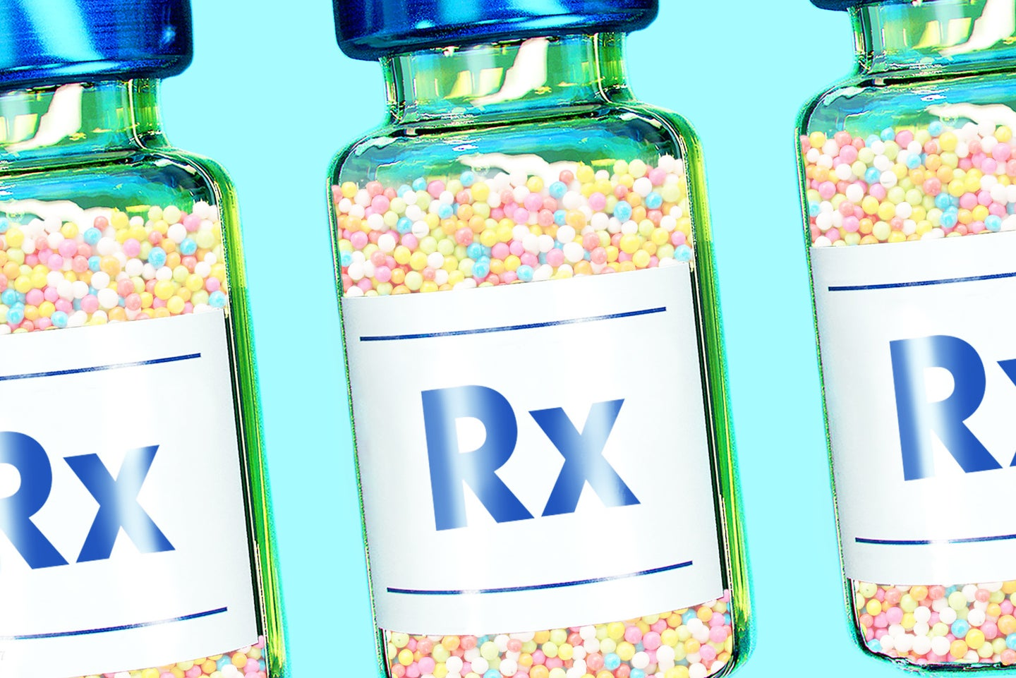 """three vaccine bottles with """"RX"""" on their labels, filled with small frozen beads of ice cream"""