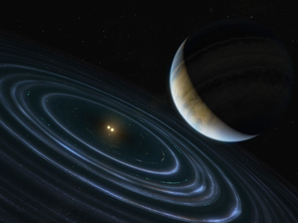 An exoplanet orbits two stars in this artist's interpretation