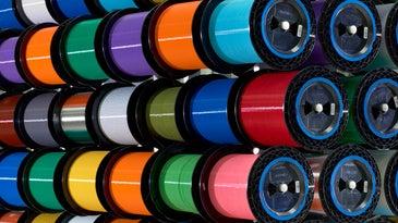Colorful spools of fiber optic glass.