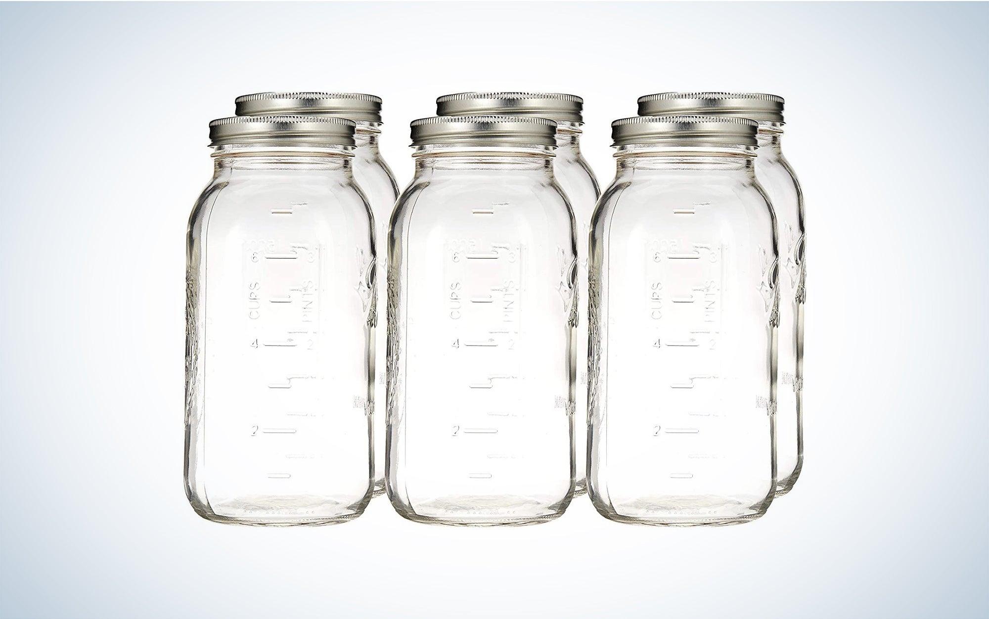 six glass 64-ounce Ball mason jars with metal lids