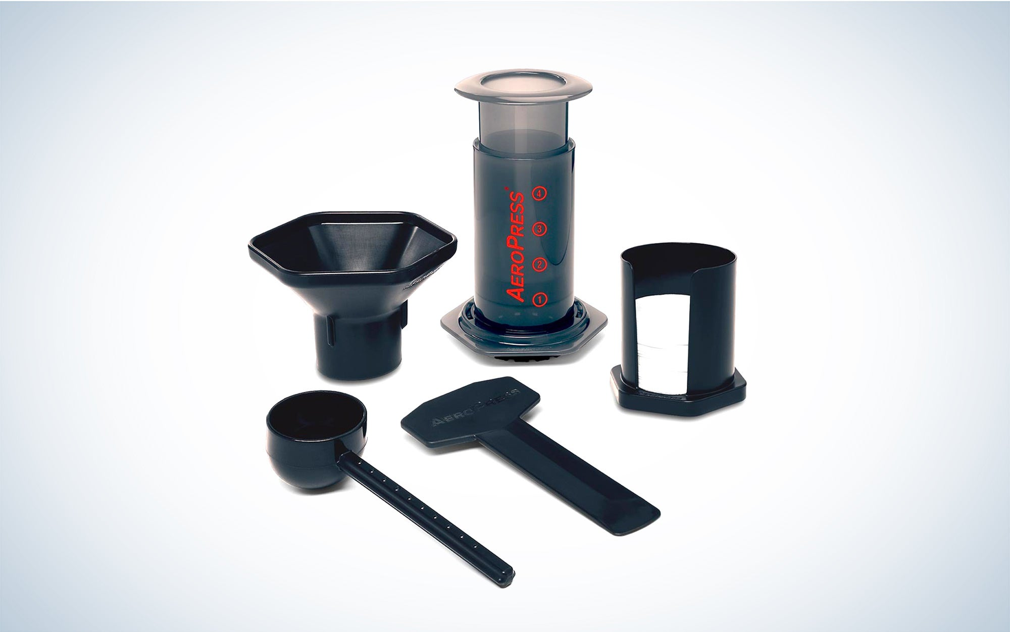 an AeroPress coffee press with funnel, scoop, stirrer, microfilters, and filter holder accessories