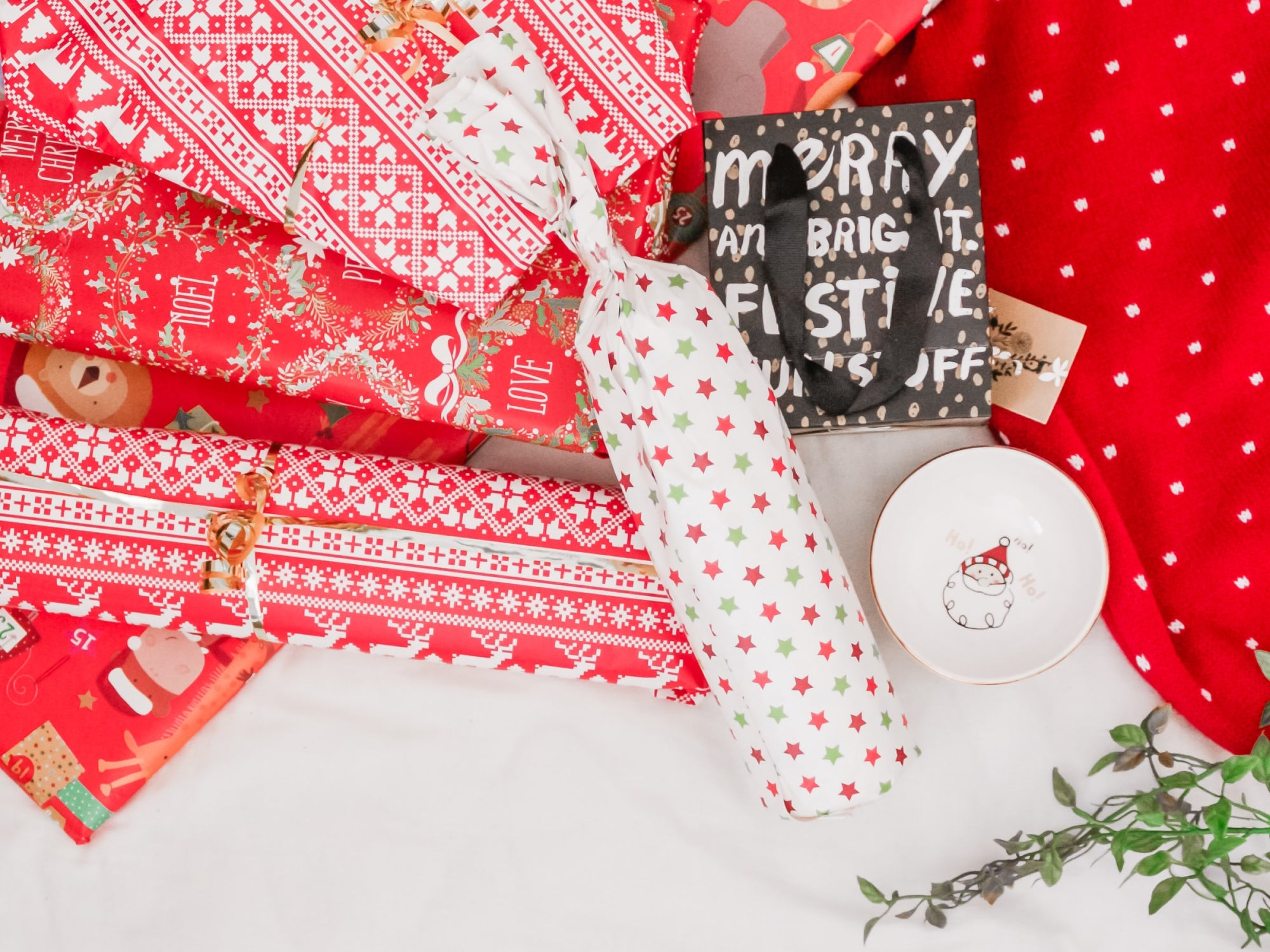 a photo of wrapping paper and a Christmas gift shaped like a cylinder