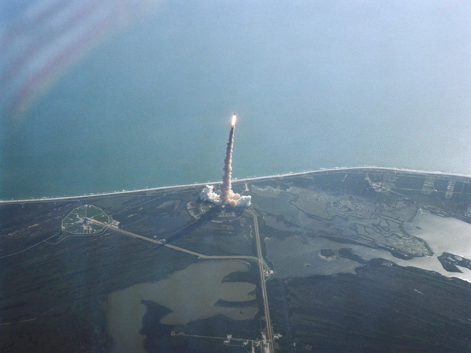 NASA space shuttle Challenger blasts off.