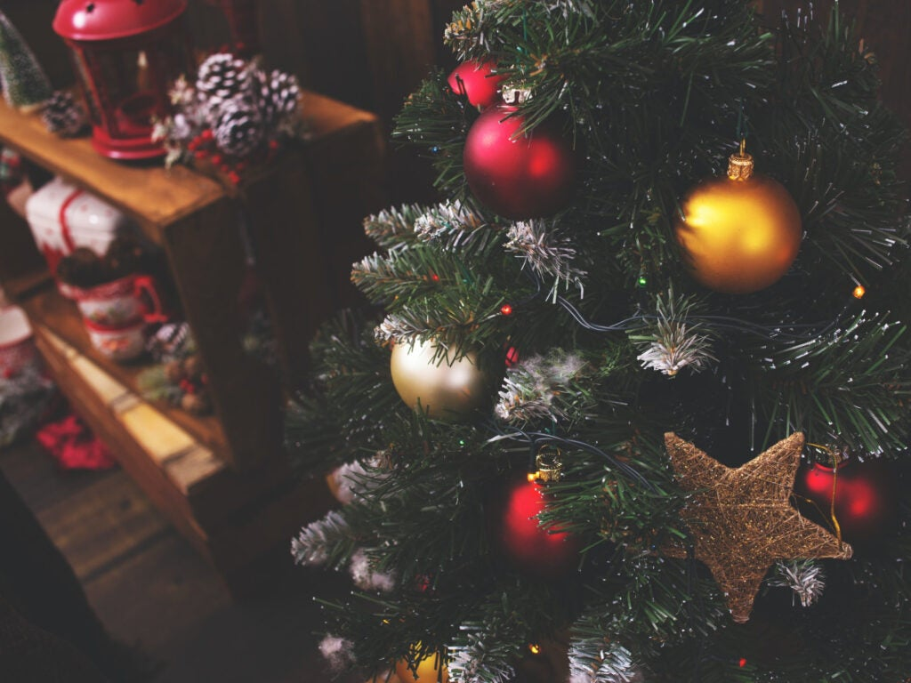 an artificial Christmas tree and other holiday decorations