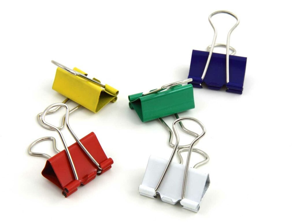 Five binder clips on a white background.