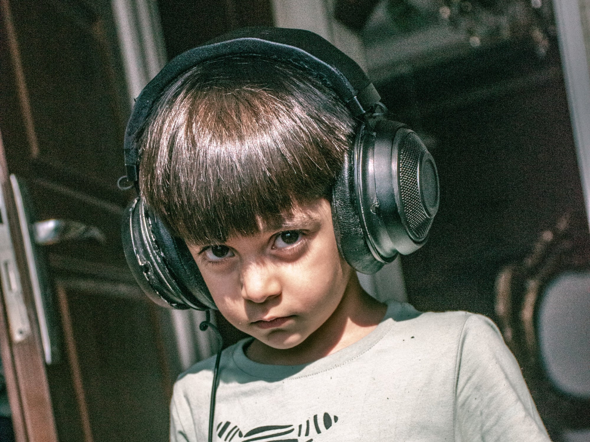 a child wearing large headphones
