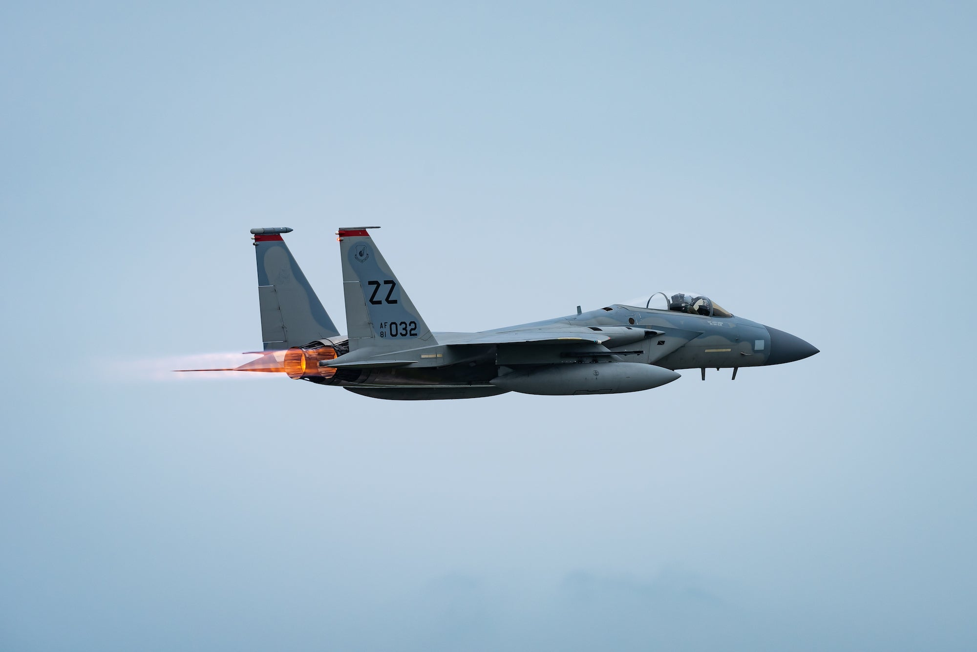 An F-15C Eagle fighter jet takes off.