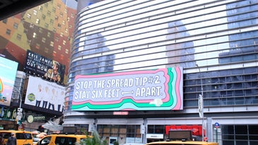 sign in new york city saying 'stop the spread tip #2 stay six feet apart'